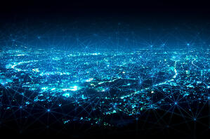 Smart city at night with blue hue