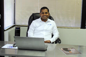 Navin Nageli at his desk