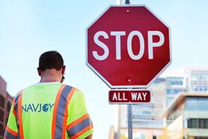 Navjoy employee assessing stop sign